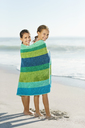 Girls wrapped in towel on beach - CAIF12463