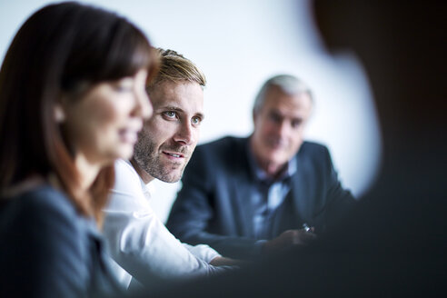 Businessman listening in meeting - CAIF12622