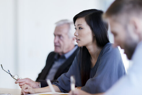 Businesswoman listening in meeting - CAIF12631