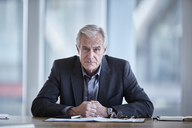 Portrait serious senior businessman in conference room - CAIF12652