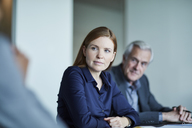 Attentive businesswoman listening in meeting - CAIF12661