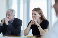 Attentive business people listening in meeting - CAIF12664