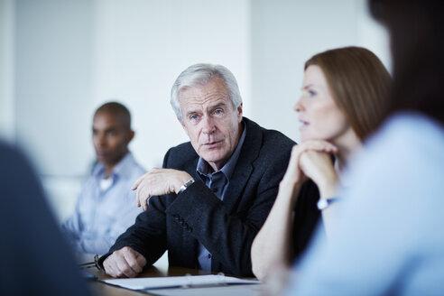 Senior businessman listening in meeting - CAIF12667