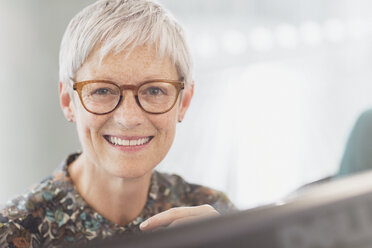 Portrait smiling senior businesswoman with eyeglasses - CAIF12856