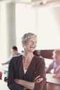 Laughing senior woman in adult education classroom - CAIF12889