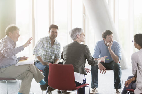 Business people talking in meeting - CAIF12913