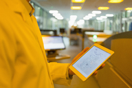 Engineer with digital tablet in factory - CAIF12979