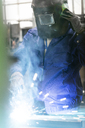 Welder in protective workwear working in factory - CAIF13147