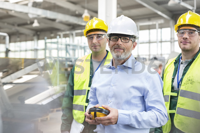 Portrait confident engineer and workers in protective workwear - CAIF13168