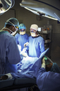 Surgeons performing surgery in operating room - CAIF13324