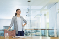 Confident businesswoman in conference room - CAIF13399