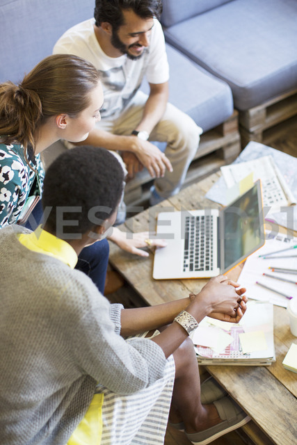 Creative business people working at laptop in office - CAIF13597