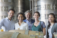 Portrait confident winery employees in cellar - CAIF13648