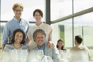 Portrait smiling friends in sunny restaurant - CAIF13702