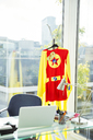Superhero costume hanging in business office - CAIF13759