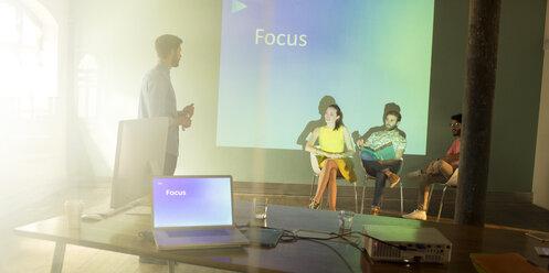 Business people preparing audio visual presentation on Focus - CAIF13837