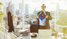 Businessman revealing superhero costume under suit - CAIF13927
