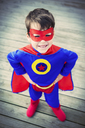 High angle view of superhero boy with hands on hips - CAIF13975