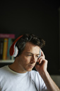 Man with headphones on listening - CAIF13987