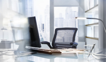 Empty desk in modern office - CAIF13990