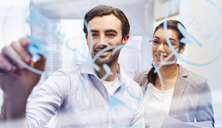 Office workers behind glass with blue marker writing on it - CAIF14002