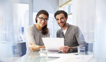Portrait of man and woman working together in office - CAIF14020