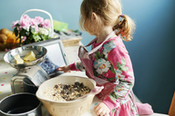 Girl with digital tablet baking in kitchen - CAIF14041