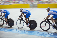 Track cycling team riding in velodrome - CAIF14110