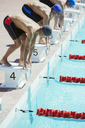 Swimmers poised at starting blocks - CAIF14137
