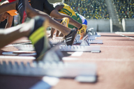 Runners poised at starting blocks on track - CAIF14146