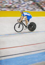 Track cyclist riding in velodrome - CAIF14149