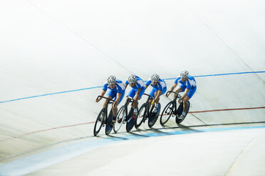Track cyclists riding in velodrome - CAIF14158