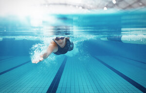 Swimmer racing in pool - CAIF14176
