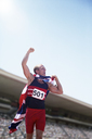 Track and field athlete cheering with British flag - CAIF14179