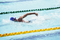 Swimmers racing in pool - CAIF14182