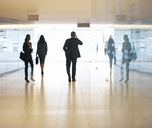 Business people walking in lobby - CAIF14206