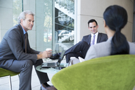 Business people meeting in lobby - CAIF14227