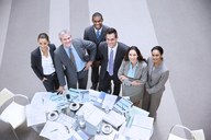 High angle portrait of smiling business people at table - CAIF14236