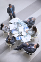 High angle view of businessman leading meeting - CAIF14239