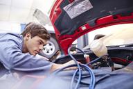 Mechanic working on car engine - CAIF14428