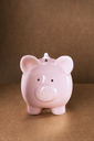 Close up of piggy bank on counter - CAIF14482