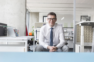 Portrait confident businessman with eyeglasses in office - CAIF14764