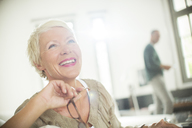 Older woman smiling indoors - CAIF14800