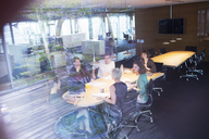 Business people talking in office meeting - CAIF14857
