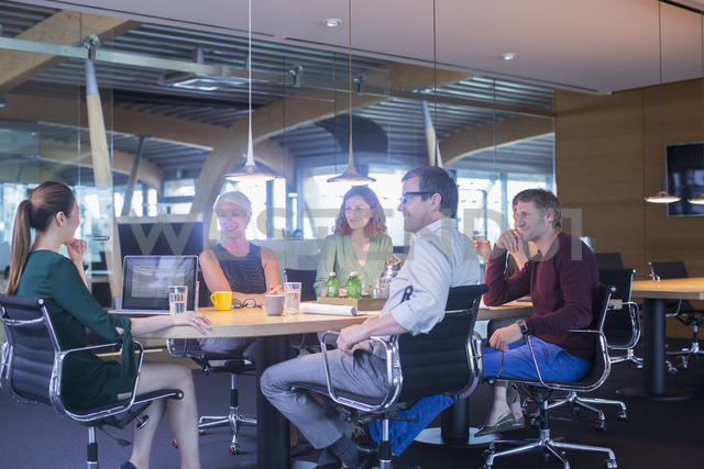 Business people talking in office meeting - CAIF14881