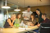 Business people talking in office meeting - CAIF14887
