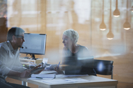Business people talking at office desk - CAIF14896