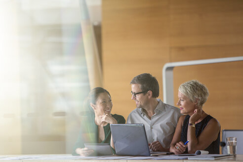 Business people talking in office meeting - CAIF14899