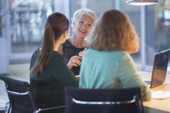 Businesswomen talking in office meeting - CAIF14911