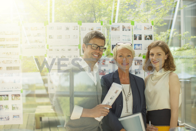 Business people smiling in office - CAIF14926
